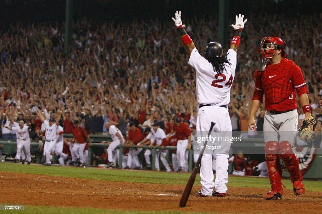 Manny Ramirez #24 of the Boston Red Sox celebrates after connecting for a three-run home run to defeat the Los Angeles Angels, 6-3, in Game 2 of the American League Division Series at Fenway Park October 5, 2007 in Boston, Massachusetts.