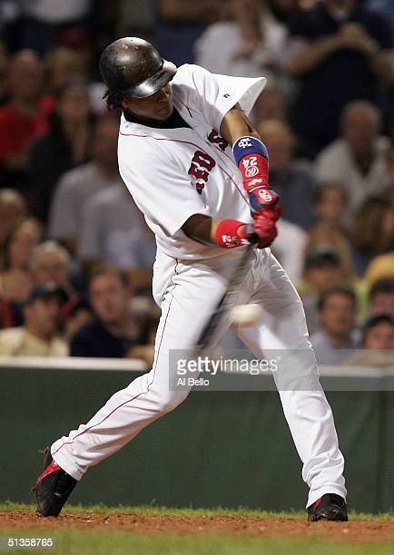 Manny Ramirez of the Boston Red Sox hits the go ahead run in the eighth inning against the New York Yankees on September 25 2004 at Fenway Park in...