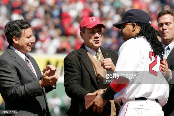 Manny Ramirez of the Boston Red Sox is presented with a World Championship ring by from the left Red Sox Chairman and coowner Tom Werner Red Sox...