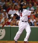 Manny Ramirez of the Boston Red Sox watches the flight of a fly ball during his last at bat with the Red Sox against the Los Angeles Angels of...