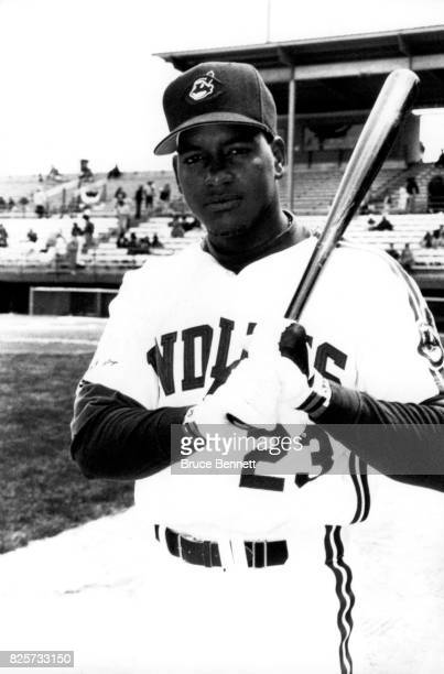 Manny Ramirez of the Cleveland Indians poses for a portrait with a baseball bat before an MLB Spring Training game circa March 1993 in Scottsdale...