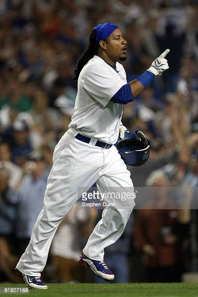 Manny Ramirez of the Los Angeles Dodgers celebrates after hitting a two run home run in the bottom of the fifth inning off of pitcher Cole Hamels of...