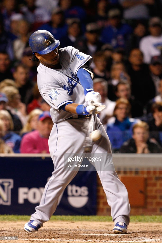 Manny Ramirez #99 of the Los Angeles Dodgers hits a RBI single in the top of the eighth inning against the Chicago Cubs in Game Two of the NLDS during the 2008 MLB Playoffs at Wrigley Field on October 2, 2008 in Chicago, Illinois. The Dodgers won 10-3.