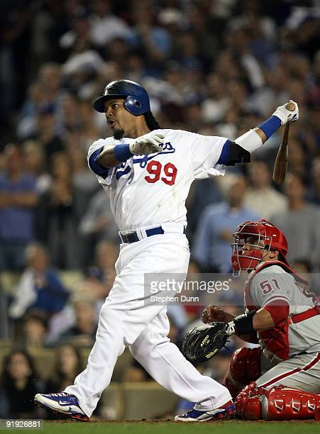 Manny Ramirez of the Los Angeles Dodgers hits a two run home run in the bottom of the fifth inning off of pitcher Cole Hamels of the Philadelphia...