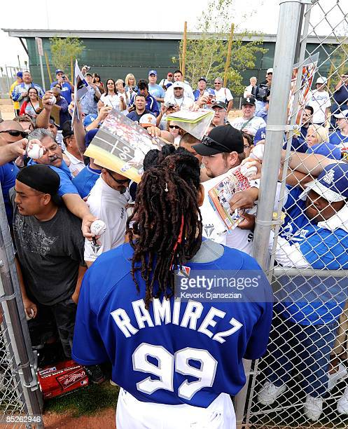 Manny Ramirez of the Los Angeles Dodgers makes his way to the clubhouse as he signs autographs after batting practice before a spring training game...