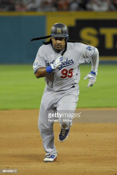 Manny Ramirez of the Los Angeles Dodgers runs to third base during a MLB game against the Florida Marlins at Sun Life Stadium on April 10 2010 in...