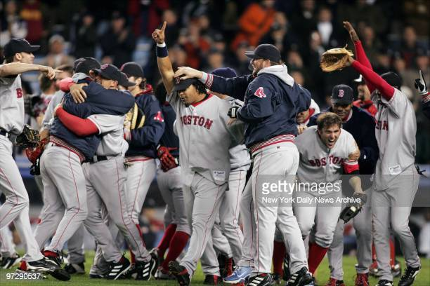 Manny Ramirez points out that the Boston Red Sox are No 1 as players celebrate on the field after their 103 victory over the New York Yankees in Game...