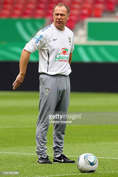 Mano Menezes issues instructions during a training session of the Brazil National football team at MercedesBenz Arena on August 9 2011 in Stuttgart...
