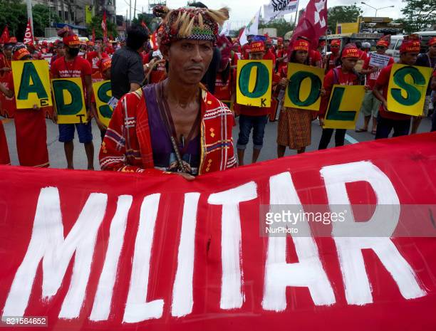 A Manobo datu attends a rally coinciding President Rodrigo Duterte's annual State of the Nation Address in Quezon City northeast of Manila...