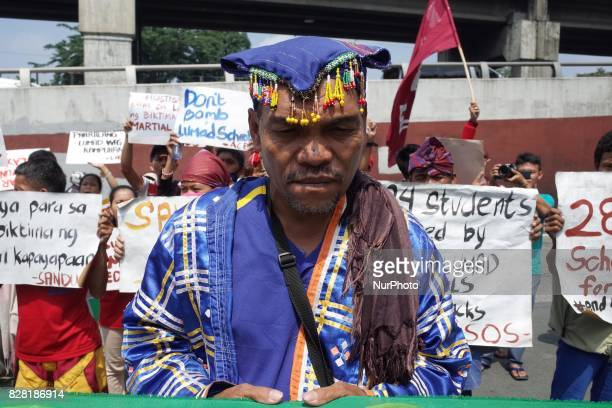A Manobo indigenous tribesman attends a rally coinciding the International Day of the World's Indigenous Peoples outside Camp Aguinaldo in Quezon...