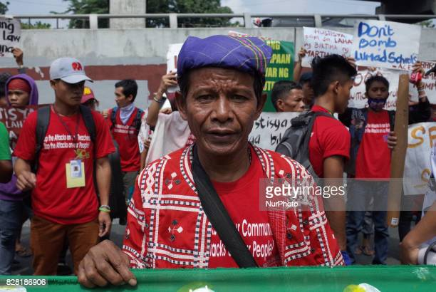 A Manobo indigenous tribesman poses for a photograph during a rally coinciding the International Day of the World's Indigenous Peoples outside Camp...