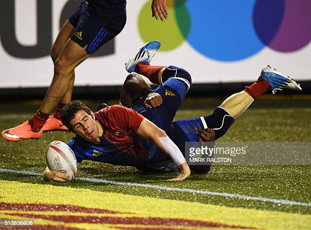 Manoel Dall Igna of France scores a try despite being tackled by Isake Katonibau of Fiji during their Men's 2016 USA Sevens Rugby Tournament match at...
