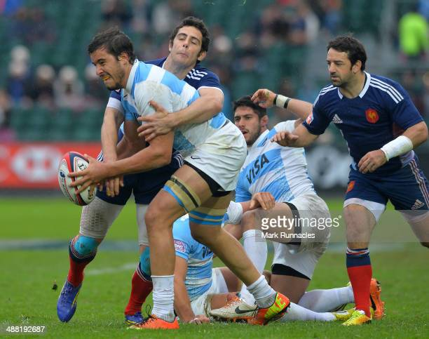 Manoel Dall Igna of France tackles Martin Chiappesoni of Argentina during the IRB Glasgow Sevens Day Two at Scotstoun Stadium on May 4 2014 in...