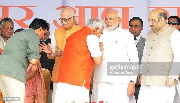 Manohar Lal Khattar Haryana's new chief minister and Capt Abhimanyu seeking blessing of Prime minister Narendra Modi Amit shah President BJP and LK...