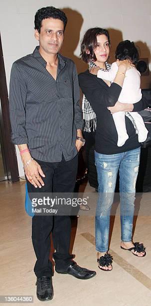 Manoj Bajpai with wife during Farah Khan's house warming bash in Mumbai on December 20 2011