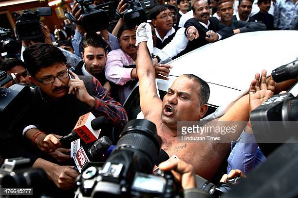 Manoj Sharma who claimed to be a lawyer from Gwalior talks to the media after he threw ink at Sahara chairman Subrata Roy as he arrived at the...
