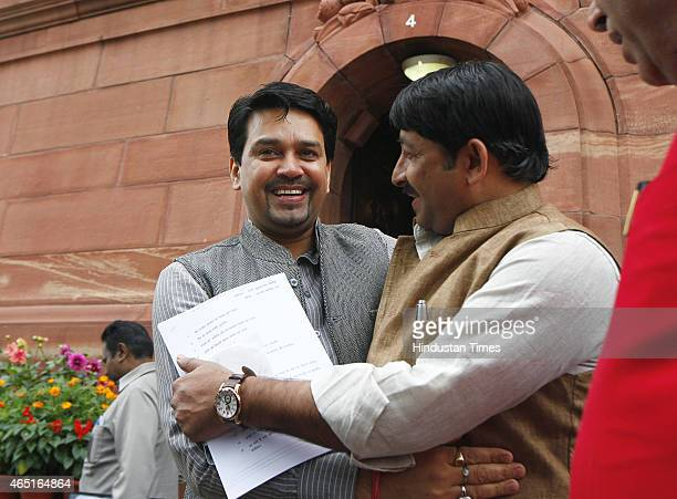 Manoj Tiwari congrats Anurag Thakur after latter won BCCI election as Secretary at the Parliament House during Budget Session on March 3 2015 in New...
