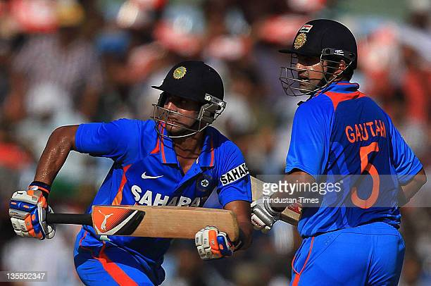 Manoj Tiwary and Gautam Gambhir of India run between the wickets during the 5th One Day International between India and West Indies at the TNCA MA...