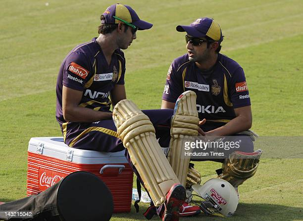 Manoj Tiwary and Gautam Gambhir of Kolkata Knight Riders speak during a Kolkata Knight Riders practice session at Barbati Stadium on April 21 2012 in...