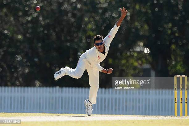 Manoj Tiwary of India A bowls during the Quadrangular Series match between Australia A and India A at Allan Border Field on July 8 2014 in Brisbane...