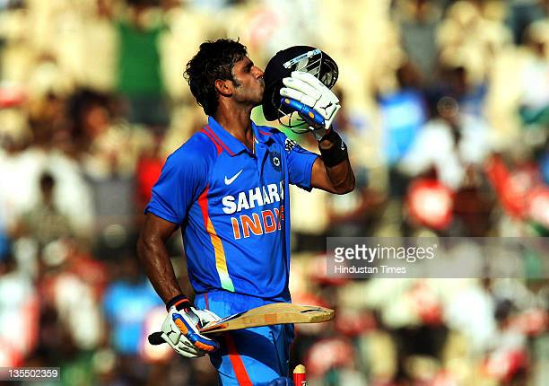 Manoj Tiwary of India kisses his helmet after reaching his halfcentury during the 5th One Day International between India and West Indies at the TNCA...