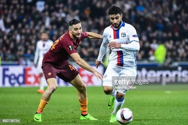 Manolas Kostas of As Roma and Nabil Fekir of Lyon during the Uefa Europa League Round of 16 first leg match between Olympique Lyonnais Lyon and As...