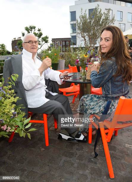 Manolo Blahnik and Catherine Bailey attend British Vogue editor Alexandra Shulman's leaving party at Dock Kitchen on June 22 2017 in London England