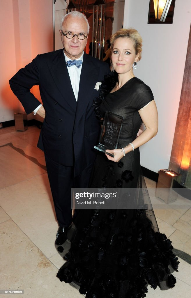 Manolo Blahnik (L) and Gillian Anderson, winner of the Television Icon of the Year award, attend the Harper's Bazaar Women of the Year awards at Claridge's Hotel on November 5, 2013 in London, England.