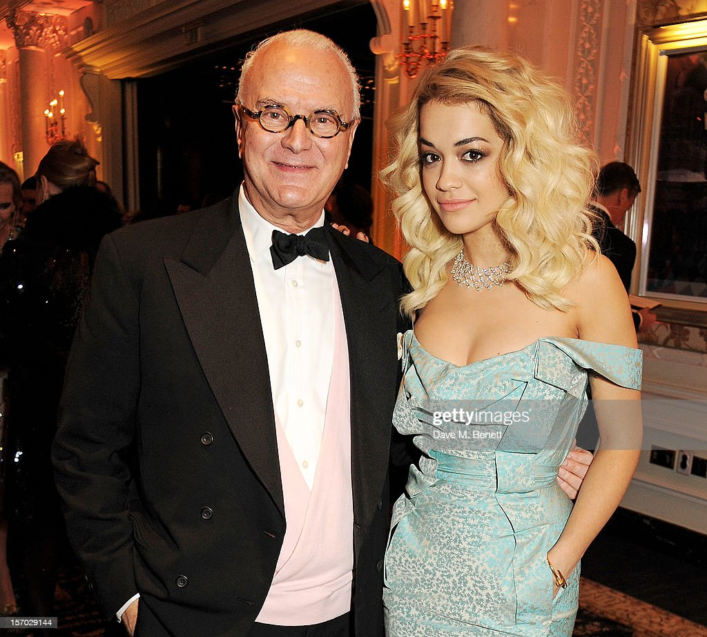 Manolo Blahnik (L) and <a gi-track='captionPersonalityLinkClicked' href=/galleries/search?phrase=Rita+Ora&family=editorial&specificpeople=5686485 ng-click='$event.stopPropagation()'>Rita Ora</a> attend a drinks reception at the British Fashion Awards 2012 at The Savoy Hotel on November 27, 2012 in London, England.