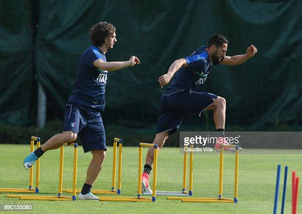 Manolo Gabbiadini and Danilo D'Ambrosio of Italy in action during the training session at Coverciano at Coverciano on May 30 2017 in Florence Italy