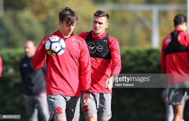 Manolo Gabbiadini and Dusan Tadic during a Southampton FC training session at the Staplewood Campus on October 12 2017 in Southampton England