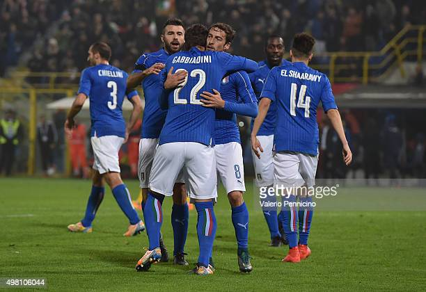 Manolo Gabbiadini celebrate with teammate Claudio Marchisio and Andrea Barzagli after scoring a goal during the international friendly match between...