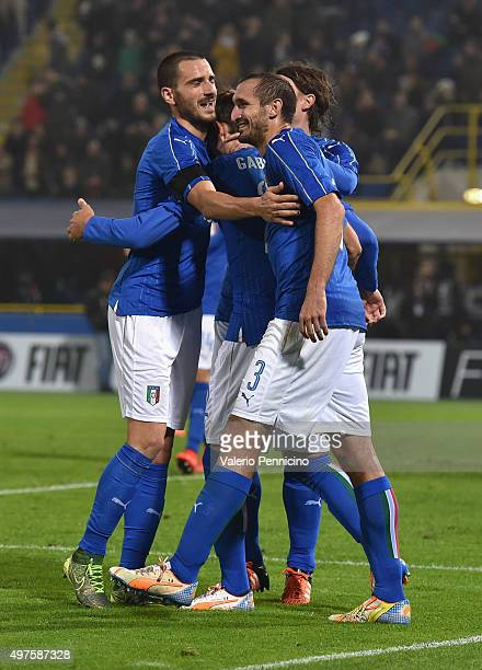 Manolo Gabbiadini celebrate with teammate Leonardo Bonucci and Giorgio Chiellini after scoring a goal during the international friendly match between...