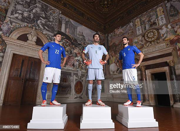 Manolo Gabbiadini Gianluigi Buffon and Davide Astori pose during the launch of new Puma home kit at Palazzo Vecchio on November 9 2015 in Florence...