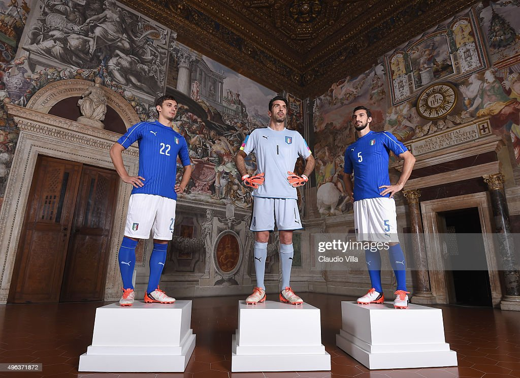 Manolo Gabbiadini, Gianluigi Buffon and Davide Astori pose during the launch of new Puma home kit at Palazzo Vecchio on November 9, 2015 in Florence, Italy.