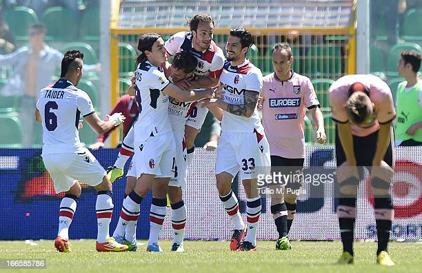 Manolo Gabbiadini of Bologna celebrates with team mates after scoring the equalizing goal during the Serie A match between US Citta di Palermo and...
