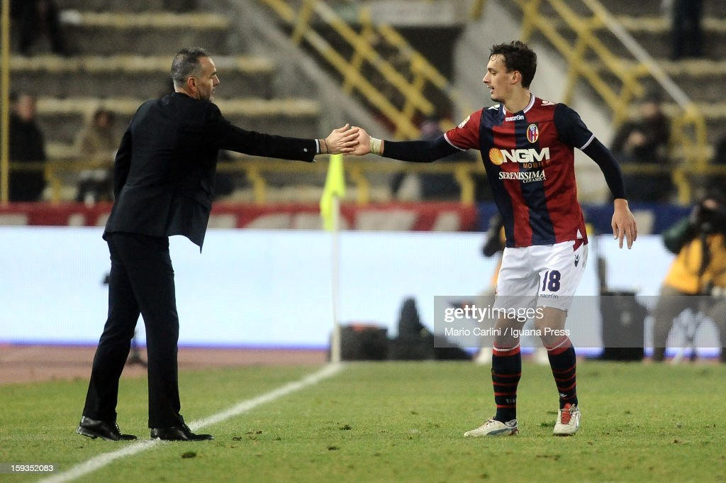 Manolo Gabbiadini # 18 of Bologna FC celebrates with his head coach <a gi-track='captionPersonalityLinkClicked' href=/galleries/search?phrase=Stefano+Pioli&family=editorial&specificpeople=6314383 ng-click='$event.stopPropagation()'>Stefano Pioli</a> after scoring his team's fourth goal during the Serie A match between Bologna FC and AC Chievo Verona at Stadio Renato Dall'Ara on January 12, 2013 in Bologna, Italy.