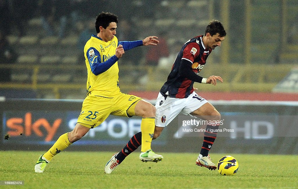 Manolo Gabbiadini # 18 of Bologna FC ( R ) competes the ball with Kamil Vacek # 25 of AC Chievo Verona ( L ) during the Serie A match between Bologna FC and AC Chievo Verona at Stadio Renato Dall'Ara on January 12, 2013 in Bologna, Italy.