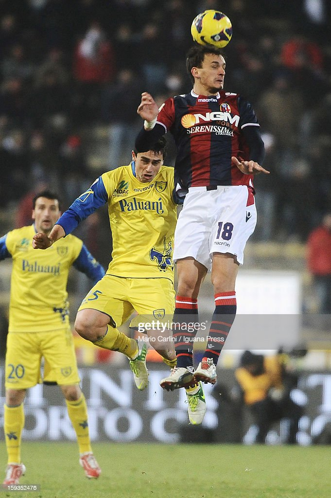 Manolo Gabbiadini # 18 of Bologna FC ( R ) heads the ball over Kamil Vacek # 25 of AC Chievo Verona ( L ) during the Serie A match between Bologna FC and AC Chievo Verona at Stadio Renato Dall'Ara on January 12, 2013 in Bologna, Italy.