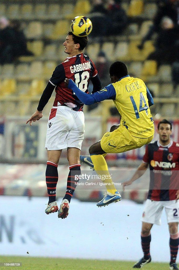 Manolo Gabbiadini # 18 of Bologna FC wins a header with Isaac Cofie # 14 of AC Chievo Verona during the Serie A match between Bologna FC and AC Chievo Verona at Stadio Renato Dall'Ara on January 12, 2013 in Bologna, Italy.