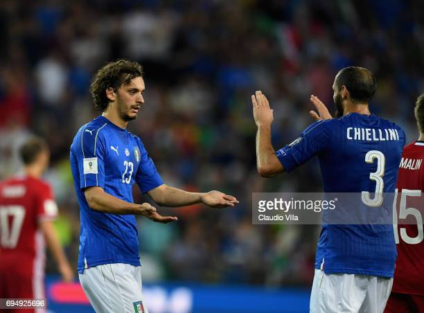Manolo Gabbiadini of Italy celebrates after scoring with Giorgio Chiellini the fifth goal during the FIFA 2018 World Cup Qualifier between Italy and...