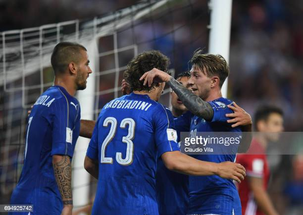 Manolo Gabbiadini of Italy celebrates with teammates after scoring the fifth goal during the FIFA 2018 World Cup Qualifier between Italy and...