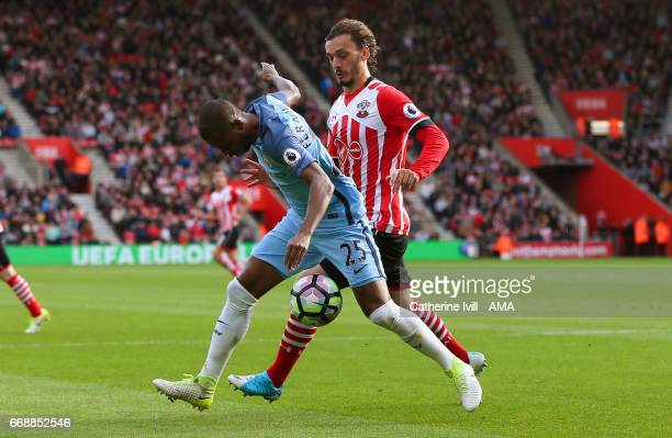 Manolo Gabbiadini of Southampton and Fernandinho of Manchester City during the Premier League match between Southampton and Manchester City at St...