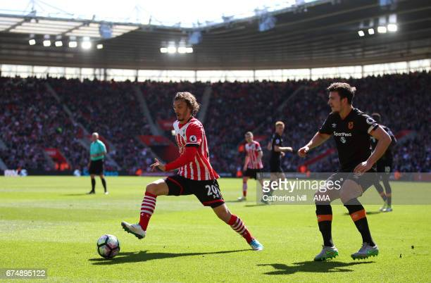 Manolo Gabbiadini of Southampton and Harry Maguire of Hull City during the Premier League match between Southampton and Hull City at St Mary's...