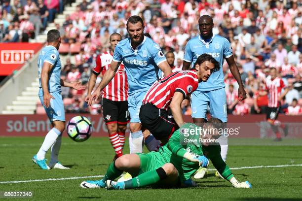 Manolo Gabbiadini of Southampton and Jack Butland of Stoke City clash during the Premier League match between Southampton and Stoke City at St Mary's...