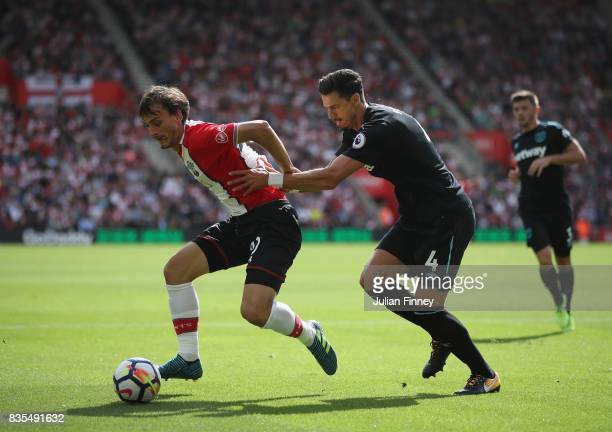 Manolo Gabbiadini of Southampton and Jose Fonte of West Ham United during the Premier League match between Southampton and West Ham United at St...