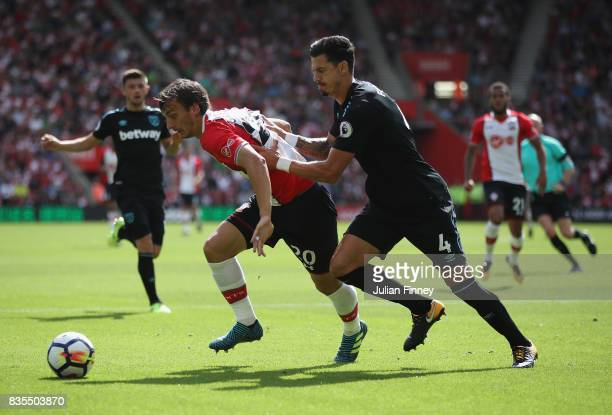 Manolo Gabbiadini of Southampton and Jose Fonte of West Ham United battle for possession during the Premier League match between Southampton and West...