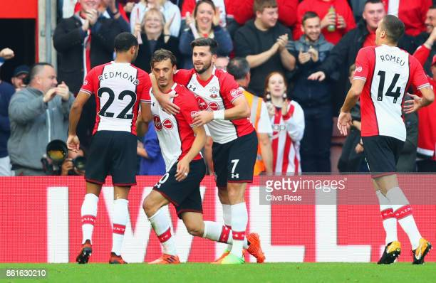 Manolo Gabbiadini of Southampton celebrates as he scores their first and equalising goal with team mates during the Premier League match between...