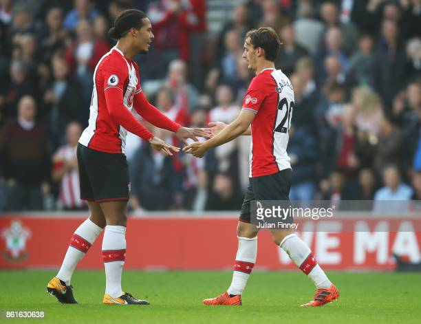 Manolo Gabbiadini of Southampton celebrates as he scores their first and equalising goal with team mate Virgil van Dijk during the Premier League...