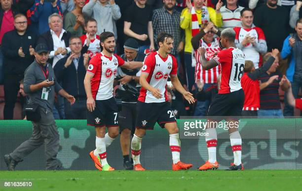 Manolo Gabbiadini of Southampton celebrates as he scores their second goal from the penalty spot with Shane Long and Mario Lemina during the Premier...